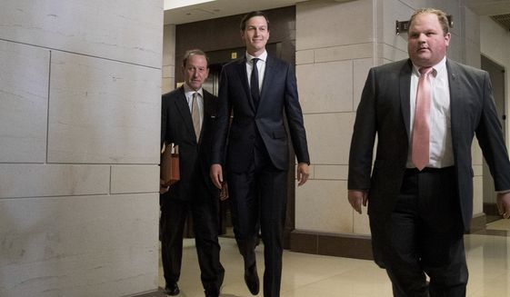 White House senior adviser Jared Kushner, second from right, accompanied by his attorney Abbe Lowell, left, arrives on Capitol Hill in Washington, Tuesday, July 25, 2017, to meet behind closed doors before the House Intelligence Committee on the investigation into possible collusion between Russian officials and the Trump campaign.(AP Photo/Andrew Harnik)