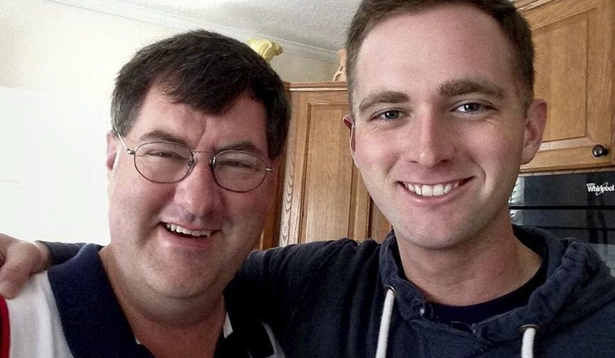 In this undated photo provided by David Taylor Sr., he poses with his son David Taylor, right, a former Marine. Taylor Sr. told The Associated Press on Tuesday, July 25, 2017, that he was notified by the U.S. State Department that his son was killed earlier this month in Syria while fighting for a Kurdish militia battling the Islamic State group. (Courtesy of David Taylor Sr. via AP)