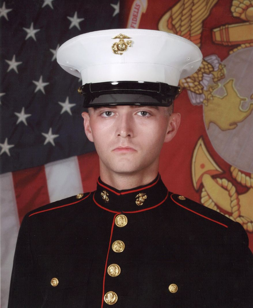In this undated photo provided by David Taylor Sr., former Marine David Taylor poses for an official portrait while in the Marine Corps. David Taylor Sr. told The Associated Press on Tuesday, July 25, 2017, that he was notified by the U.S. State Department that his son was killed earlier this month in Syria while fighting for a Kurdish militia battling the Islamic State group. (U.S. Marine Corps/David Taylor Sr. AP)