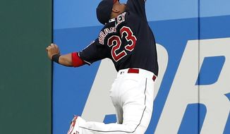 Cleveland Indians' Michael Brantley makes a running catch for the out on Los Angeles Angels' Albert Pujols during the fourth inning in a baseball game, Tuesday, July 25, 2017, in Cleveland. (AP Photo/Ron Schwane)
