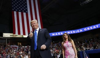 President Donald Trump and first lady Melania Trump arrive for a rally, Tuesday, July 25, 2017, at the Covelli Centre in Youngstown, Ohio (AP Photo/Carolyn Kaster)