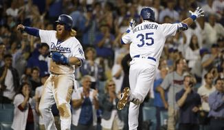 Los Angeles Dodgers' Cody Bellinger, right, celebrates his three-run home run with Justin Turner during the eighth inning of a baseball game against the Minnesota Twins, Monday, July 24, 2017, in Los Angeles. (AP Photo/Jae C. Hong)