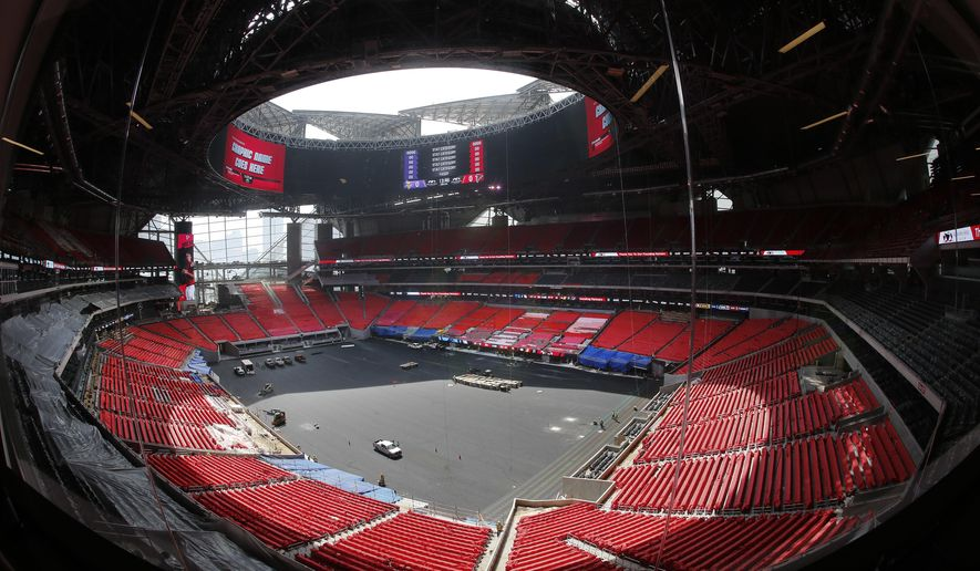 The field is shown during a tour of mercedes benz stadium for Tours of mercedes benz stadium atlanta