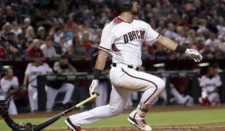 Arizona Diamondbacks David Peralta follows through on an RBI-base hit against the Atlanta Braves during the fourth inning of a baseball game, Monday, July 24, 2017, in Phoenix. (AP Photo/Matt York)