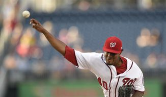 Washington Nationals starting pitcher Edwin Jackson delivers a pitch during the first inning of a baseball game against the Milwaukee Brewers, Tuesday, July 25, 2017, in Washington. (AP Photo/Nick Wass)