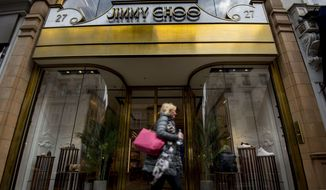 "This is a April 24, 2017, file photo of the Jimmy Choo shop on New Bond Street, London. American fashion brand Michael Kors has bought luxury shoemaker Jimmy Choo in a deal worth $1.35 billion (896 million pounds.) Kors said Tuesday, July 25, 2017, the London-listed Jimmy Choo is ""the ideal partner"" that will be bolstered with further development of its online presence. (Lauren Hurley/PA, File via AP)"