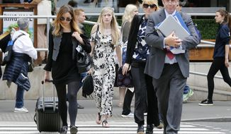 Connie Yates, center, mother of critically ill baby Charlie Gard arrives at the Royal Court of Justice in London, Tuesday, July 25, 2017. Lawyers for the family of critically ill infant Charlie Gard and the hospital treating him were returning to court for a hearing Tuesday, a day after the baby's parents said they were dropping their long legal battle to get him experimental treatment.The subject of Tuesday's hearing at the High Court in London was not immediately clear. (AP Photo/Frank Augstein)