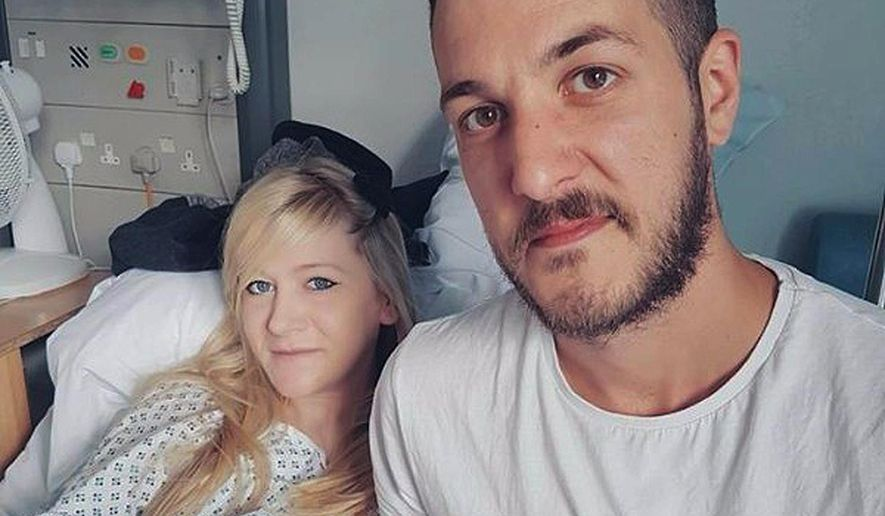 This is an undated hand out photo of Chris Gard and Connie Yates with their son Charlie Gard provided by the family, at Great Ormond Street Hospital, in London. The parents of  critically ill infant Charlie Gard, Monday July 24, 2017 withdrew their court fight seeking permission to take the child to the United States for medical treatment. Chris Gard and Connie Yates wept as their attorney revealed the results of brain scans. The 11-month-old has a rare genetic condition, and his parents fought hard to receive an experimental treatment. Doctors said it wouldn't help and contended Charlie should be allowed to die peacefully. (Family of Charlie Gard via AP) ** FILE**