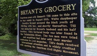 This June 2012 photo shows a historic sign commemorating the lynching of Emmett Till in Money, Miss. After the opposite side of the sign, not shown, was vandalized earlier this year, officials had it repaired. The refurbished sign was rededicated Tuesday. (AP Photo/Don Schanche Jr.)