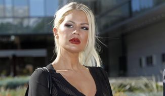 FILE - In this Wednesday, Jan. 14, 2015 file photo, Chloe Goins, appears before reporters outside Los Angeles police headquarters in Los Angeles. Officials say Goins, a model who accuses Bill Cosby of sexually assaulting her at a Playboy Mansion party in 2008 has been arrested Sunday, July 23, 2017, on suspicion of bringing heroin to a San Diego jail. (AP Photo/Nick Ut, File)