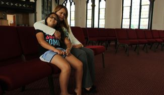 Nury Chavarria, 43, poses with her 9-year-old daughter, Hayley inside  Iglesia De Dios Pentecostal church in New Haven, Conn., on Monday, July 24, 2017. Chavarria has sought sanctuary from deportation because she needs to be with her four children, and understands she has become a symbol in the larger fight over immigration reform.   (AP Photo/Pat Eaton-Robb)