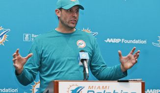 Miami Dolphins head coach Adam Gase gestures as he speaks during a news conference, Tuesday, July 25, 2017, at the Dolphins training facility in Davie, Fla. Gase believes his roster is more talented than a year ago when he was a rookie coach for the Dolphins, who start training camp Thursday. (AP Photo/Wilfredo Lee)
