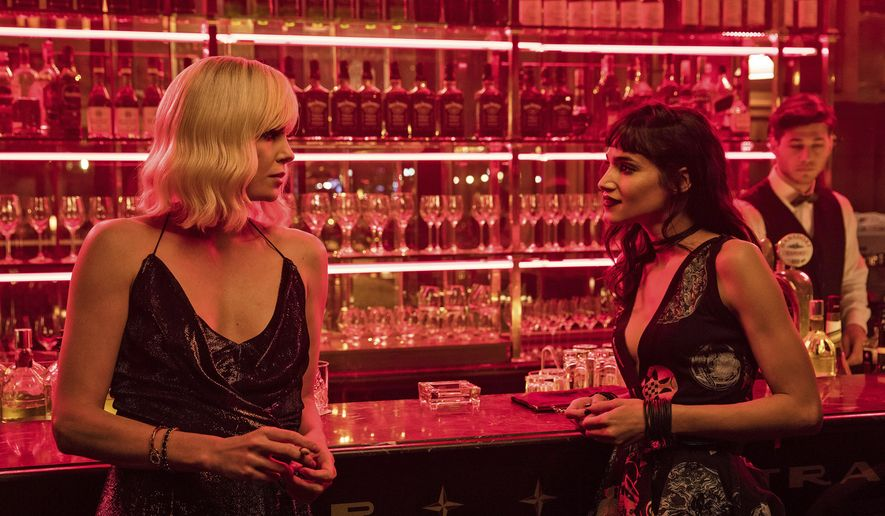 """This image released by Focus Features shows Charlize Theron, left, and Sofia Boutella in """"Atomic Blonde."""" (Jonathan Prime/Focus Features via AP)"""