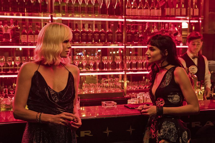 "This image released by Focus Features shows Charlize Theron, left, and Sofia Boutella in ""Atomic Blonde."" (Jonathan Prime/Focus Features via AP)"