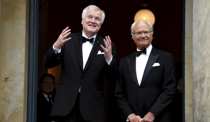 """King Carl Gustaf of Sweden, right, and Bavarian Governor Horst Seehofer arrive for the opening of the opera festival in Bayreuth, Germany, Tuesday, July 25, 2017. The Richard Wagner Festival will be opened with the opera """"The Master-Singers of Nuremberg"""". (Tobias Hase/dpa via AP)"""