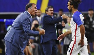 United States head coach Bruce Arena calls out to his team as United States' Graham Zusi (19) steps off the field during a CONCACAF Gold Cup semifinal soccer match in Arlington, Texas, Saturday, July 22, 2017. (AP Photo/Jeffrey McWhorter)