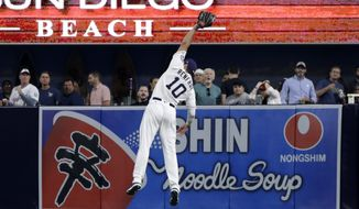 San Diego Padres right fielder Hunter Renfroe makes a leaping catch for an out against New York Mets' Wilmer Flores during the fifth inning of a baseball game Monday, July 24, 2017, in San Diego. (AP Photo/Gregory Bull)
