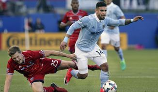 FILE - In this April 22, 2017, file photo, Sporting Kansas City forward Dom Dwyer (14) takes control of the ball against FC Dallas defender Walker Zimmerman (25) during the first half of an MLS soccer match, in Frisco, Texas. Sporting Kansas City forward Dom Dwyer has been traded to Orlando City for what could be a Major League Soccer record $1.6 million in allocation money. (AP Photo/LM Otero, File)