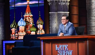"This July 18, 2017 image released by CBS show host Stephen Colbert on ""The Late Show with Stephen Colbert.""  The CBS ""Late Show"" host scored his largest margin of victory since his debut week nearly two years ago for shows that featured segments filmed during his recent trip to Moscow and St. Petersburg. (Scott Kowalchyk/CBS via AP)"