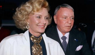 FILE - In this July 12, 1988 file photo Frank Sinatra and his wife Barbara appear at Milton Berle's 80th birthday party in Los Angeles. Barbara Sinatra, a prominent advocate and philanthropist for abused children, died Tuesday, July 25, 2017, of natural causes at her Rancho Mirage, California, home. She was 90. (AP Photo/File)