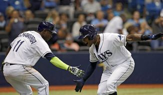 Tampa Bay Rays' Tim Beckham, right, celebrates his three-run home run with Adeiny Hechavarria during the second inning of a baseball game against the Baltimore Orioles Tuesday, July 25, 2017, in St. Petersburg, Fla. (AP Photo/Mike Carlson)