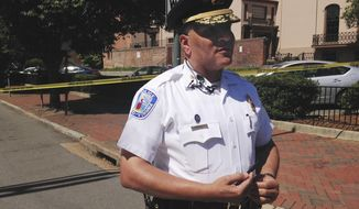 Richmond Police Chief Alfred Durham addresses reporters near the scene of a shooting in the city's downtown, Tuesday, July 25, 2917, in Richmond, Va. Durham said police shot and killed a man carrying an ax and a knife. Durham said one officer was hit in what appears to be friendly fire, but Durham said the officer's body armor prevented him from being seriously injured. (AP Photo/Alanna Durkin Richer)
