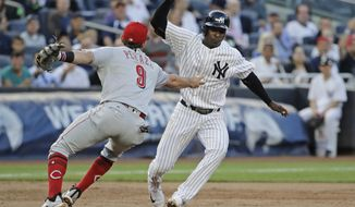 Cincinnati Reds' Jose Peraza (9) tags out New York Yankees' Didi Gregorius on a triple play during the second inning of a baseball game Tuesday, July 25, 2017, in New York. Matt Holliday scored on the play. (AP Photo/Frank Franklin II)