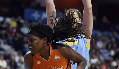 Connecticut Sun center Jonquel Jones drives to the basket as Chicago Sky center Stefanie Dolson defends during the first half of a WNBA basketball game Tuesday, July 25, 2017, in Uncasville, Conn. (Sean D. Elliot/The Day via AP)
