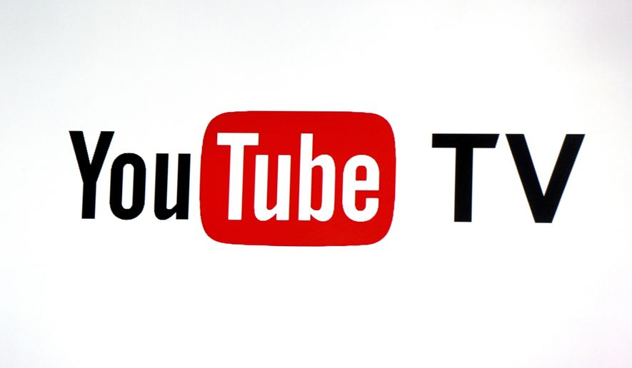FILE - This Tuesday, Feb. 28, 2017, file photo shows the YouTube TV logo at the YouTube Space LA in Los Angeles. Nielsen says it will start counting how many people are watching live TV services from online streaming companies Hulu and YouTube, giving media companies and advertisers more insight on how many folks are watching network shows beyond the traditional TV screen. (AP Photo/Reed Saxon, File)