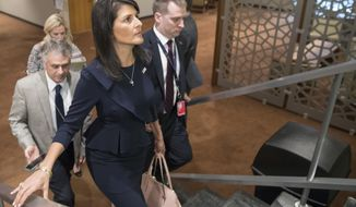 American Ambassador to the United Nations Nikki Haley, center, leaves after attending a Security Council meeting on the situation in the Middle East, including the Palestinian question, Tuesday, July 25, 2017 at United Nations headquarters. (AP Photo/Mary Altaffer)