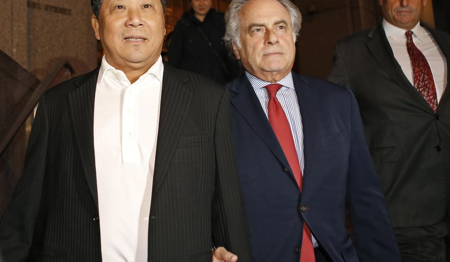 In this Oct. 26, 2015, file photo, Chinese billionaire Ng Lap Seng, left, leaves federal court with his attorney Ben Brafman after he was released on bail in connection with a U.N. bribery scheme in New York. Assistant U.S. Attorney Janis Echenberg told a jury during his trial's closing arguments Tuesday, July 25, 2017, that Ng wanted to build a center in Macau that would rival U.N. headquarters in New York in size. (AP Photo/Kathy Willens, File)