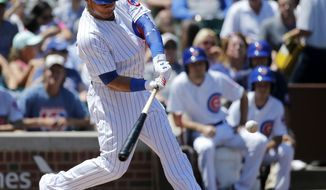 Chicago Cubs' Willson Contreras hits a three-run home run off Chicago White Sox starting pitcher Carlos Rodon during the first inning of a baseball game Tuesday, July 25, 2017, in Chicago. Ben Zobrist and Anthony Rizzo also scored on the play. (AP Photo/Charles Rex Arbogast)