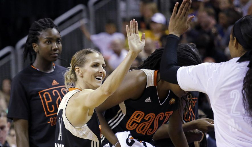 Eastern Conference's Allie Quigley, of the Chicago Sky, is congratulated by teammates after winning the 3-point contest at the WNBA All-Star basketball game Saturday, July 22, 2017, in Seattle. (AP Photo/Elaine Thompson)
