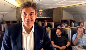 "Dr. Mehmet Oz, host of ""The Dr. Oz Show,"" surprises passengers aboard a Turkish Airlines flight from Istanbul to
