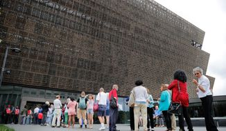While recently deceased D.C. newscaster Jim Vance of NBC will be added to the Smithsonian's African American museum, Justice Clarence Thomas is still absent. (Associated Press)