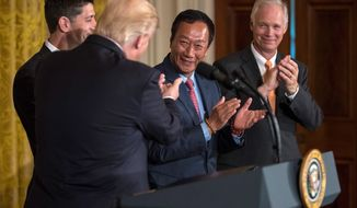 Foxconn, a Taiwanese manufacturing giant that makes iPhone components, will build a factory in Wisconsin, President Trump announced Wednesday. The $10 billion deal will initially add 3,000 jobs to the economy with the potential for as many as 13,000 jobs in the future. (Associated Press)