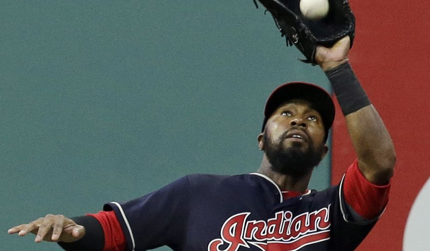 Cleveland Indians' Austin Jackson catches a fly ball hit by Los Angeles Angels' Martin Maldonado in the fourth inning of a baseball game, Wednesday, July 26, 2017, in Cleveland. (AP Photo/Tony Dejak)