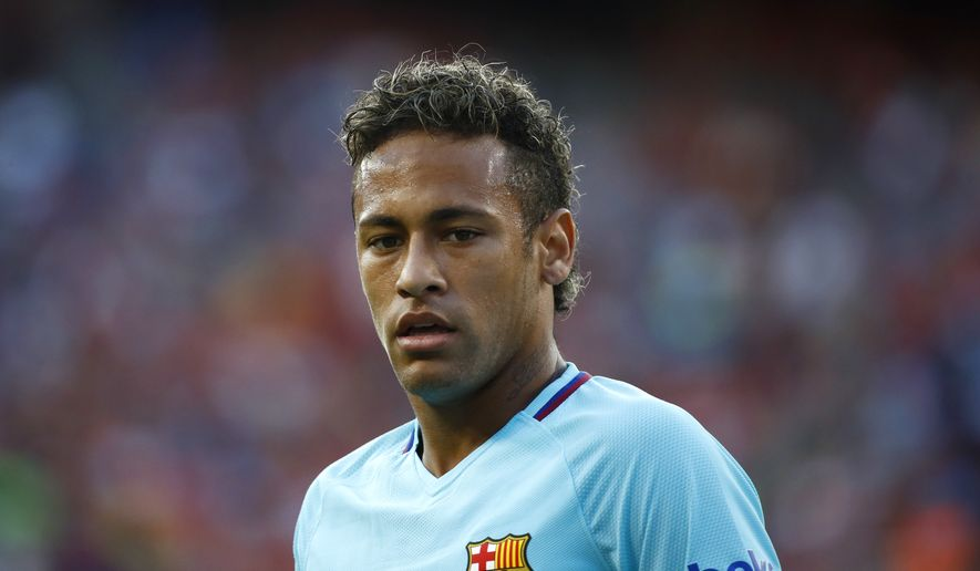 Barcelona's Neymar walks on the field during the first half of an International Champions Cup soccer match against Manchester United, Wednesday, July 26, 2017, in Landover, Md. (AP Photo/Patrick Semansky)