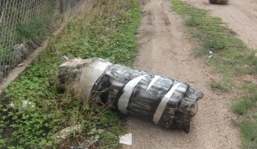 A police officer responding to 911 calls found this massive 140-pound bundle of marijuana. The package had broken apart from landing on the U.S. side after being fired over the Douglas, Arizona, border fence by a catapult.