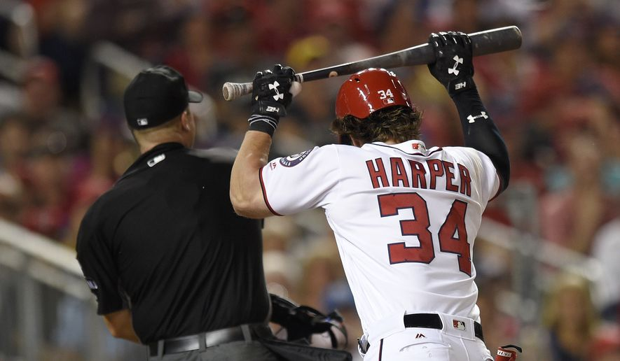 Washington Nationals' Bryce Harper (34) reacts after he was ejected from the game for arguing with home plate umpire Chris Segal, left, after he struck out during the eighth inning of a baseball game against the Milwaukee Brewers, Wednesday, July 26, 2017, in Washington. The Nationals won 8-5. (AP Photo/Nick Wass)