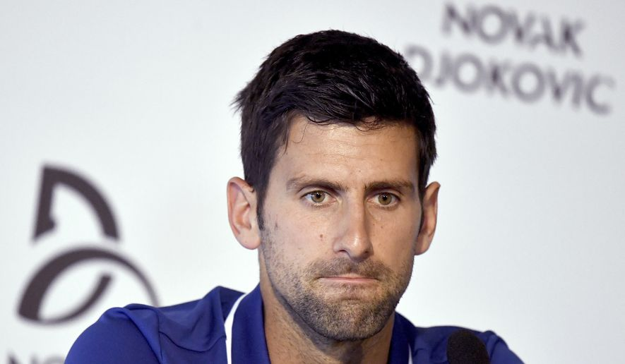Tennis player Novak Djokovic pauses during a press conference in Belgrade, Serbia, Wednesday, July 26, 2017.  Djokovic will sit out the rest of this season because of an injured right elbow, meaning he will miss the U.S. Open and end his streak of participating in 51 consecutive Grand Slam tournaments. (Andrej Isakovic, Pool Photo via AP)
