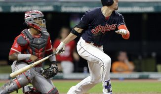 Cleveland Indians' Bradley Zimmer watches his ball after hitting a one-run double off Los Angeles Angels starting pitcher Ricky Nolasco in the seventh inning of a baseball game, Wednesday, July 26, 2017, in Cleveland. Los Angeles Angels catcher Martin Maldonado watches. Austin Jackson scored on the play. (AP Photo/Tony Dejak)