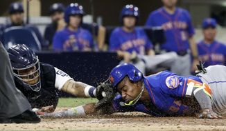 New York Mets' Yoenis Cespedes scores from third after hitting an RBI triple as San Diego Padres catcher Hector Sanchez is late with the tag during the seventh inning of a baseball game Tuesday, July 25, 2017, in San Diego. San Diego Padres first baseman Wil Myers picked up a throwing error on the play. (AP Photo/Gregory Bull)