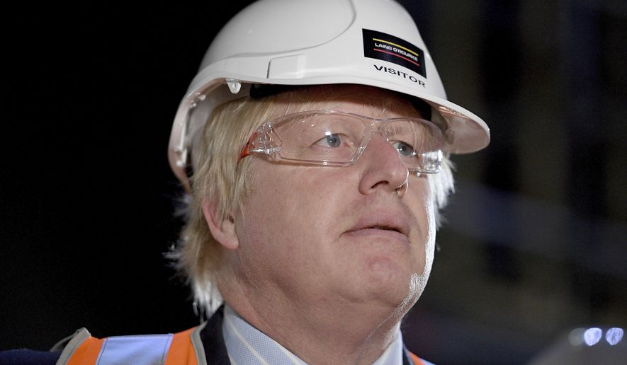 British Foreign Secretary Boris Johnson tours construction work underway at the Sydney Opera House, in Sydney, Wednesday, July 26, 2017. Johnson is in Sydney to attend AUKMIN, the annual meeting of the countries' foreign and defense ministers. (Dan Himbrechts/Pool Photo via AP)