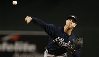 Atlanta Braves' Mike Foltynewicz throws a pitch against the Arizona Diamondbacks during the first inning of a baseball game Tuesday, July 25, 2017, in Phoenix. (AP Photo/Ross D. Franklin)