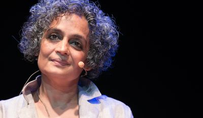 """FILE - In this Monday, June 12, 2017 file photo Indian novelist Arundhati Roy presents her book """"The Ministry of Utmost Happiness"""" at the Parco della Musica Auditorium in Rome. American authors Paul Auster and Colson Whitehead are among 13 contenders for the prestigious Man Booker Prize for fiction. The list also includes a previous winner, India's Arundhati Roy. (Giorgio OnoratiANSA via AP, File)"""