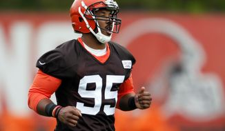 FILE - In this May 12, 2017 photo shows Cleveland Browns' Myles Garrett runs through drills during NFL football rookie minicamp in Berea, Ohio. Garrett has fully recovered from a foot sprain and is ready for training camp, the team announced Wednesday, July 26, 2017. Garrett, the No. 1 overall pick in this year's draft, suffered a left lateral foot sprain during minicamp in June.  (AP Photo/Ron Schwane, File)