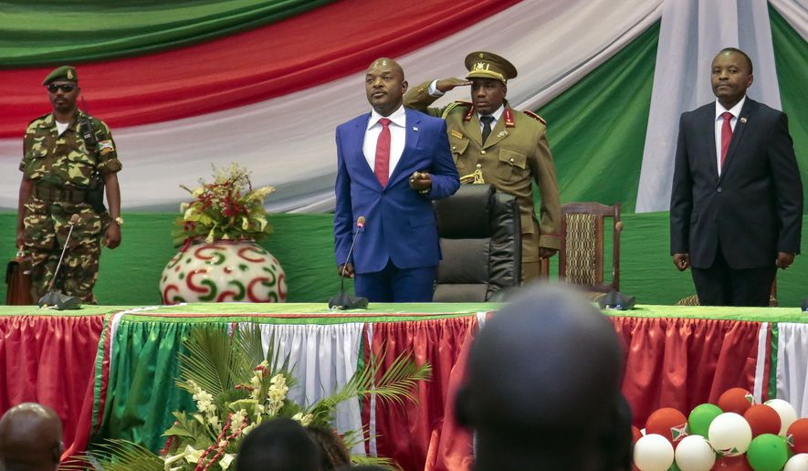 FILE - In this Thursday, Aug. 20, 2015 file photo, Burundi's President Pierre Nkurunziza is sworn in for a third term at a ceremony in the parliament in Bujumbura, Burundi. Hundreds of people have been killed and hundreds of thousands have fled the small East African nation in the two years since President Pierre Nkurunziza set off protests by declaring he would seek another term. (AP Photo/Gildas Ngingo, File)