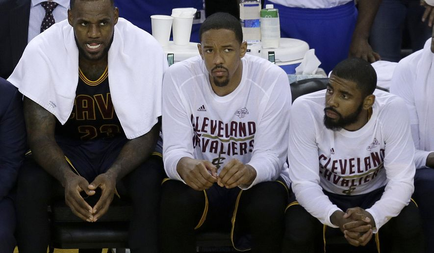 FILE - In this June 1, 2017, file photo, Cleveland Cavaliers forward LeBron James, from left, sits on the bench with center Tristan Thompson and guard Kyrie Irving during the second half of Game 1 of basketball's NBA Finals against the Golden State Warriors, in Oakland, Calif. All-Star point guard Kyrie Irving recently asked to be traded. (AP Photo/Ben Margot, File)