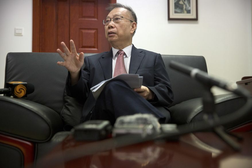 Former Chinese Vice Health Minister Huang Jiefu speaks during an interview in Beijing, Wednesday, July 26, 2017. Huang, the chief architect of China's organ transplant program, says the country is on track to lead the world in transplant surgeries by 2020. (AP Photo/Mark Schiefelbein)